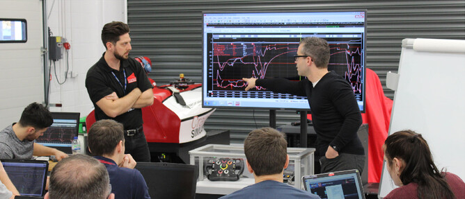 Rik Kasius (right) tutoring at the 2018 MIA School of Race Engineering